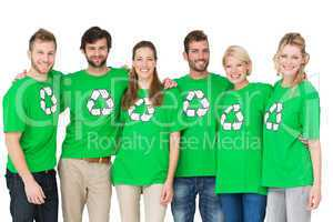 Group portrait of people wearing recycling symbol t-shirts