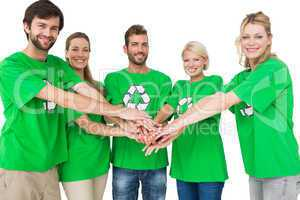 People in recycling symbol t-shirts with hands together