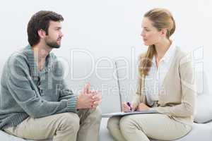 Young man in meeting with a financial adviser