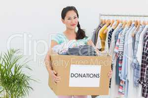 Young woman with clothes donation