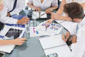 Mid section of well dressed business people in meeting