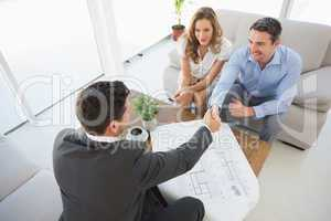 Young couple in meeting with a financial adviser