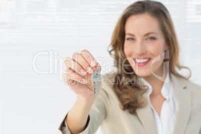 Portrait of a beautiful woman holding house keys
