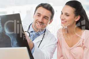 Doctor explaining x-ray report to a smiling patient