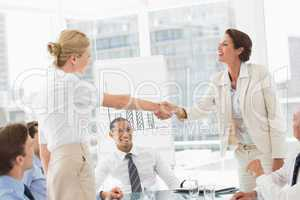 Businesswomen making a deal at a meeting