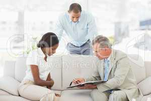 Salesman showing client where to sign the paperwork
