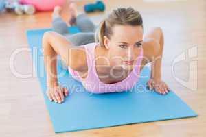 Determined beautiful woman doing push ups