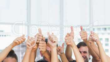 Closeup of cropped people gesturing thumbs up