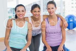 Fit women smiling in exercise room