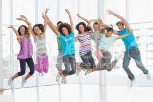 Fitness class jumping in fitness studio