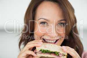 Closeup of a woman eating sandwich