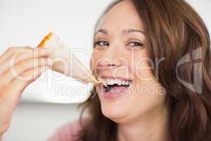 Closeup of a beautiful woman eating sandwich