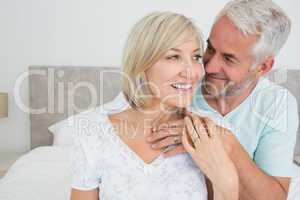 Closeup of a loving mature couple in bed