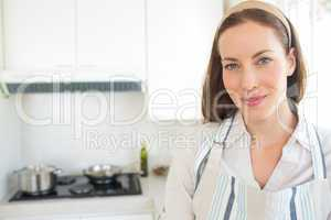 Closeup portrait of a smiling woman in kitchen