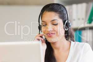 Call center representative using headset