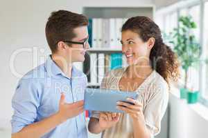 Business people communicating over digital tablet