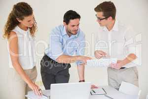 Business people discussing over document
