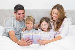Family reading storybook