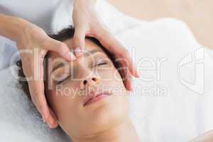 Beautiful woman having head massage