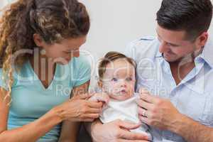 Parents spending leisure time with baby