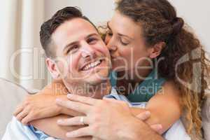 Loving woman kissing man