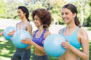 Sporty women exercising with medicine balls