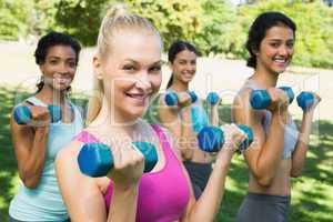 Multiethnic sporty women weightlifting