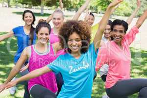 Women performing fitness dance in park