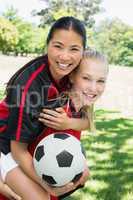 Female soccer player piggybacking teammate