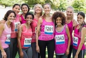 Group of women participating in breast cancer marathon