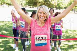 Happy winner of breast cancer marathon race