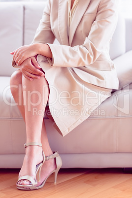 Stylish businesswoman sitting on sofa