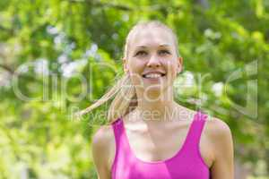 Close-up of a healthy woman in sports bra in park