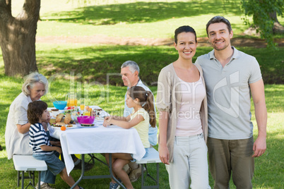 Couple with family having lunch in the lawn