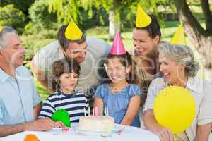 Extended family wearing party hats at birthday celebration in pa