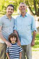 Grandfather father and son smiling at park