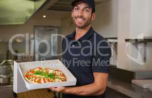 Happy pizza delivery man showing fresh pizza