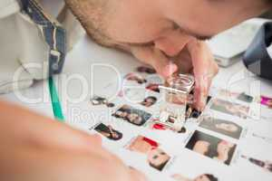 Closeup of a concentrate male artist looking at photos