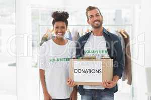 Smiling young couple with clothes donation