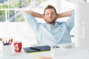 Designer relaxing at his desk