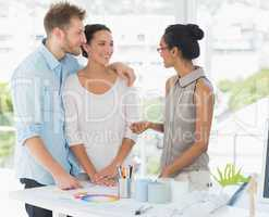 Interior designer speaking with clients