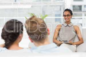 Therapist smiling at couple on the couch