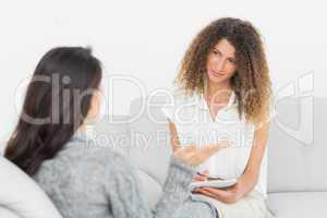 Therapist listening to her talking patient