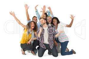Smiling group of young friends having fun doing karaoke