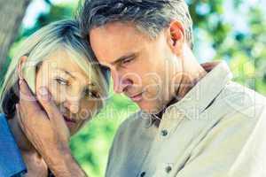 Loving man comforting woman