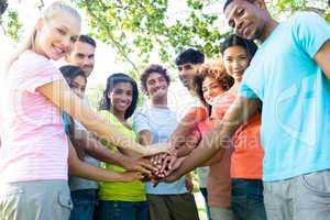 Multiethnic friends stacking hands