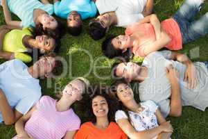 Multiethnic friends lying down in park