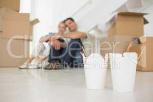 Takeaway food with blurred couple and boxes at new house