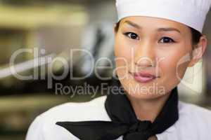 Closeup portrait of a smiling female cook