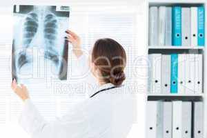 Female doctor studying Xray